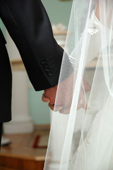 Wedding photo of married couple holding hands