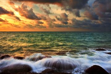Tropical sunset on the beach. Phuket island. Thailand