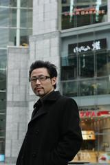Business man wears black coat