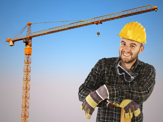 manual worker with crane background and blue sky