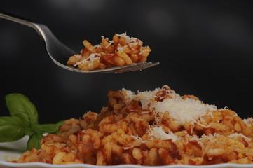 Risotto al pomodoro con formaggio grana - Primi