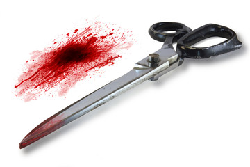 metal scissors with blood
