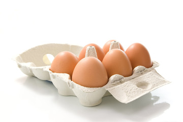 Grey box of eggs on white background