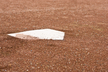 Closeup of home plate at baseball diamond