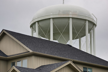 Top of house with water tower behind