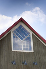 Top of A-frame building with custom window
