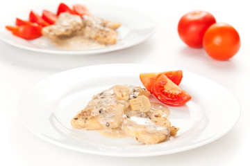 hake fillets with cheese sauce and mushrooms isolated