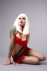 Woman wearing a red burlesque outfit.