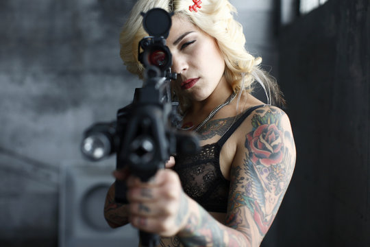 Sexy woman with assault rifle.
