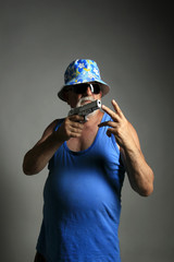 old gangster with gun