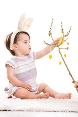 Baby playing with easter decoration