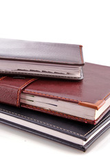 Leather notebooks on white background