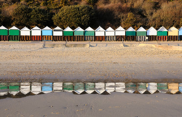 Beach huts reflection