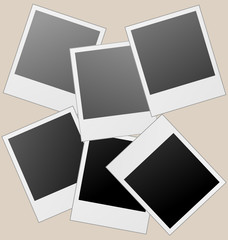 Realistic vector photo frames isolated on brown.