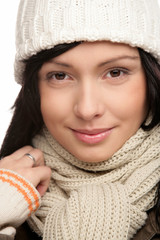 Woman wearing woolly scarf and cap