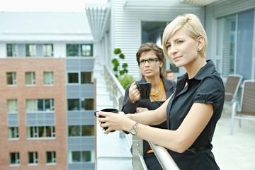 Businesswomen drinking coffee