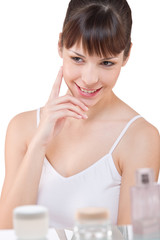 Body care: Portrait of young woman in bathroom