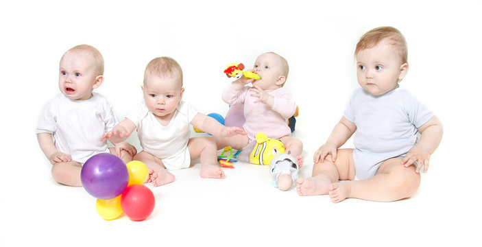 group of babies over white