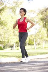 Senior Woman Jogging In Park