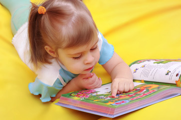 Baby with the book. Learning to read