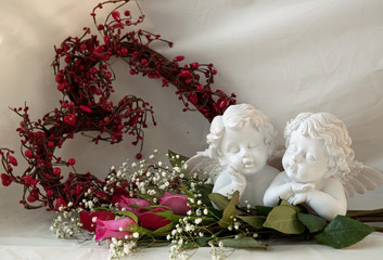 cherubs with heart shaped wreath