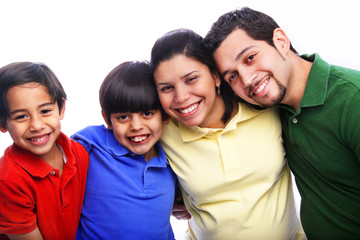 Happy Family Embracing Wearing Varied Color Shirts