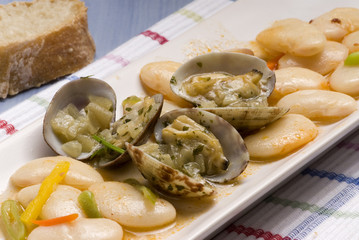Clams and beans stew. Spanish cuisine. Judiones con almejas.