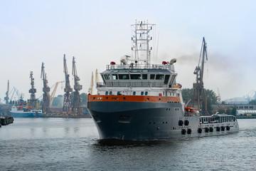 Tug ship exiting shipyard