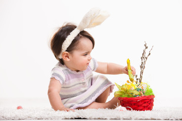 Baby playing with easter basket