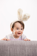 Happy baby girl in easter costume