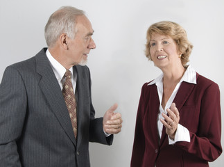 Businessman and woman in discussion