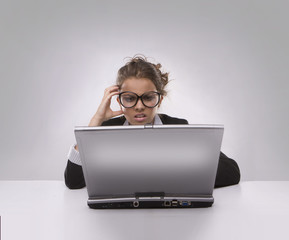 Confused woman using PC