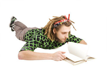 young dreadlock man reading book isolated