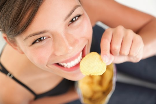 Beautiful woman eating junk food