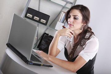 Young brunette at her contemporary office