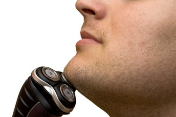 man shaving with an electric shaver