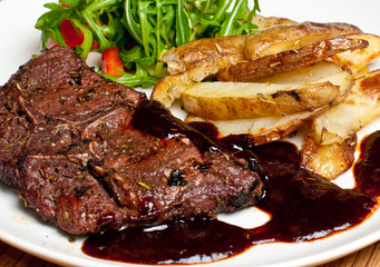 Lamb steak on a plate with potatoes