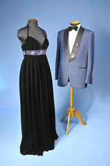 Luxurious black dress and blue dinner jacket with bow-tie