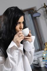 young adult enjoying coffee