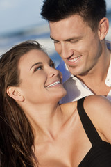 Romantic Man and Woman Couple Happy Smiling On Beach