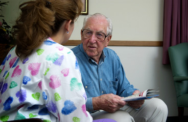 Nurse talking with senior man