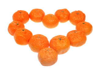 Mandarins in the form of heart on the white background