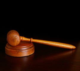 court gavel on desk, over dark background