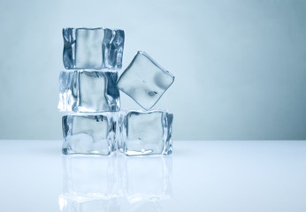 pile of ice cubes with reflection