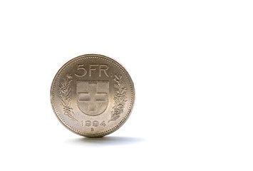 Single five Swiss franc coin isolated on white background
