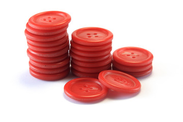 sawing red buttons