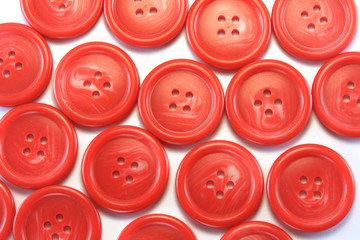 sewing red buttons