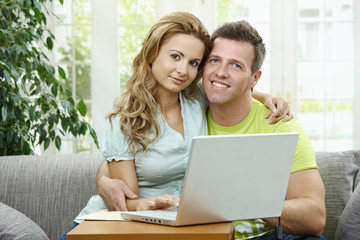 Couple using laptop computer