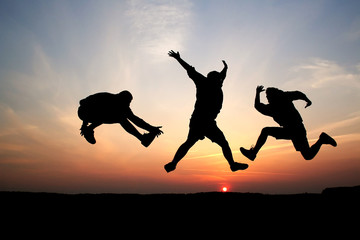 Silhouette of three men jumping 07