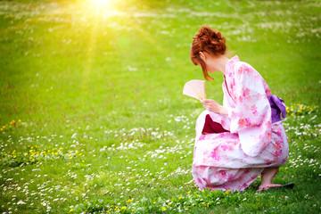 beautiful young woman in a Kimono in the Gardens
